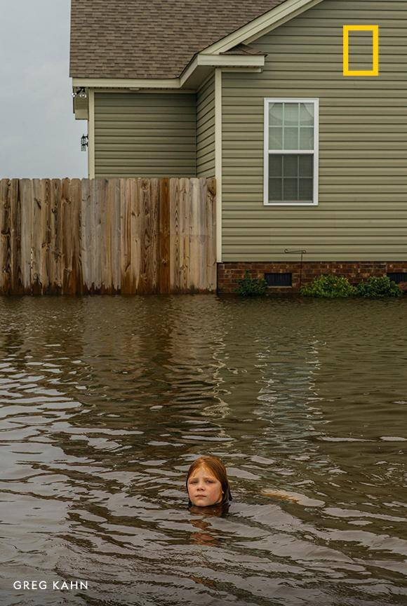 Nine-year-old Daisy Johnson plays in the flood water that washed over the streets in her neighborhood of La Grange, North Carolina. See how residents are still feeling the effects of Hurricane Florence. https://on.natgeo.com/2Npm20E