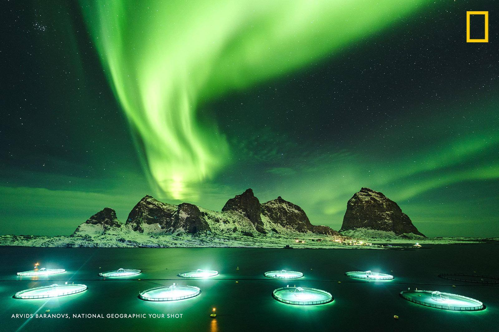 Northern lights dance over the iconic island of Sanna off the Norwegian coast in this long exposure image captured by Your Shot photographer Arvids Baranovs. https://on.natgeo.com/2TJbA7t