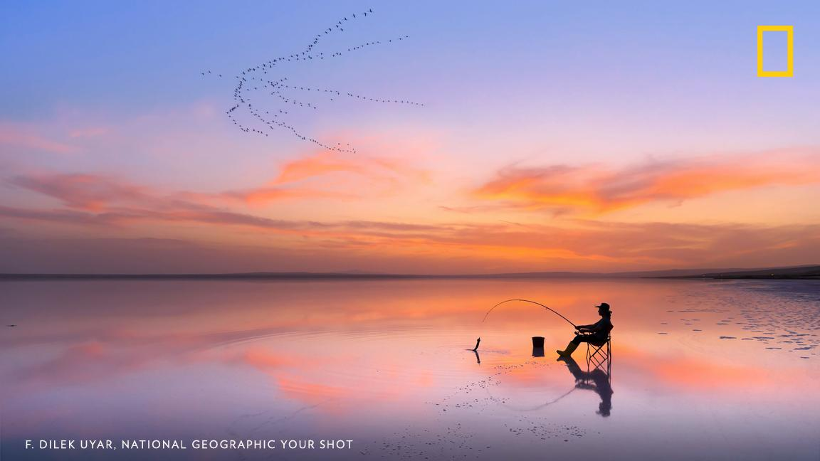 Your Shot photographer F. Dilek Uyar captured this breathtaking and serene sunset as a person fished in Ankara, Turkey https://on.natgeo.com/2KEN7Kz