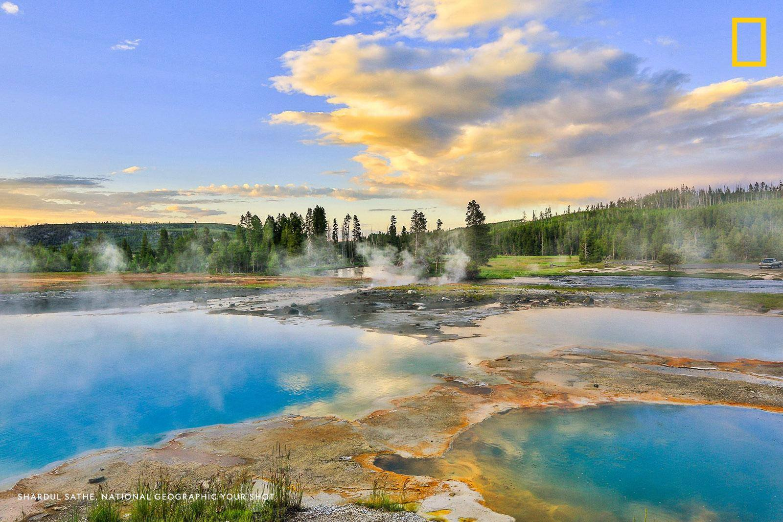 """Yellowstone—the most colorful national park I have seen,"" writes Your Shot photographer Shardul Sathe. ""We arrived at this basin before sunset to watch the deep blue acidic pool and the magic of the golden hour."" https://on.natgeo.com/2KtxPZW"