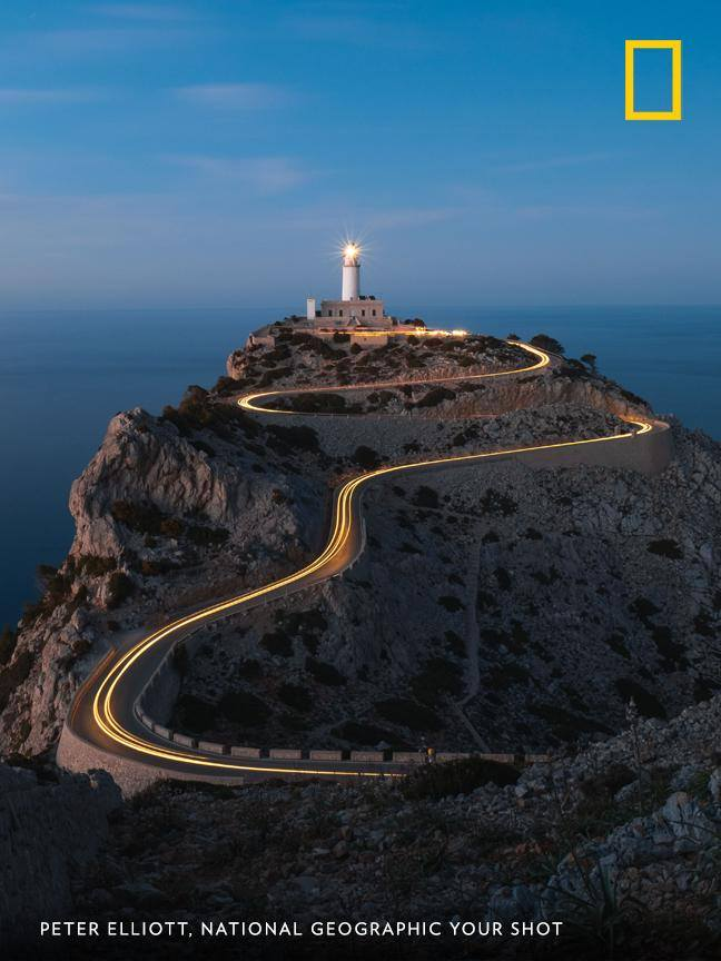 """This photo was taken at the viewpoint to Cap De Formentor on the island of Mallorca, Spain,"" writes Your Shot photographer Peter Elliott. ""The way the road leads perfectly up to the lighthouse makes this such a photogenic spot."" https://on.natgeo.com/2xhsZq8"