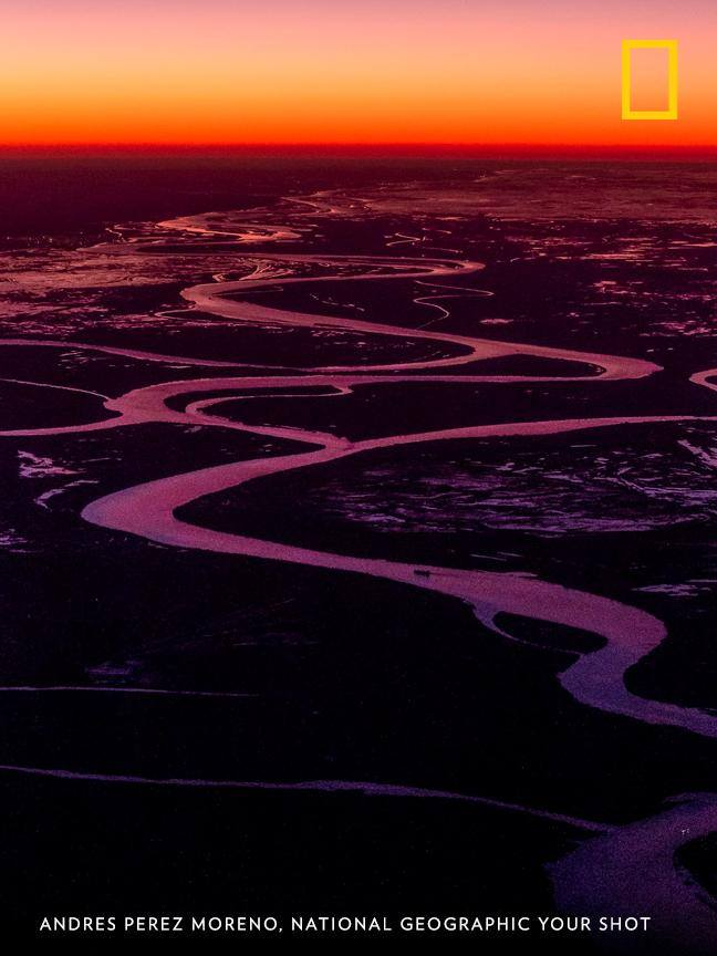 "Sunset illuminates the Paraná Delta in this gorgeous scene captured by Your Shot photographer Andres Perez Moreno. ""This dynamic ecosystem is submitted to constant floods, and is very rich in biodiversity."" https://on.natgeo.com/2YP47Wj"