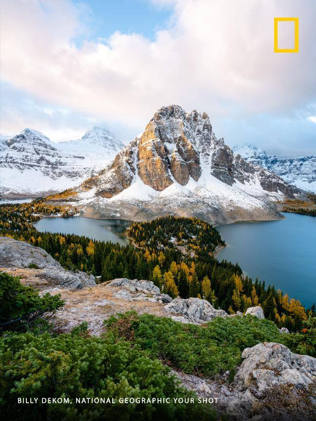 """Got up for sunrise to hike up to the Niblet in Mount Assiniboine Provincial Park for this shot,"" writes Your Shot photographer Billy Dekom. ""Suddenly the clouds started to clear and I could see Sunburst Peak along with Sunburst Lake and Cerulean Lake clearly across the way."" https://on.natgeo.com/34imPVV"
